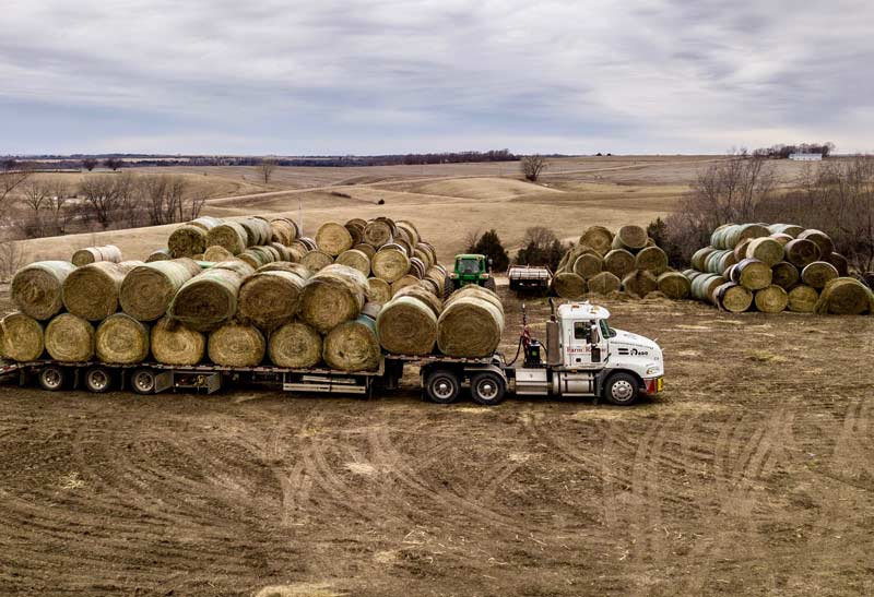 Semi-truck loaded with hay bales